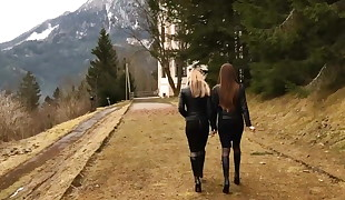 Two lady',s in taut skirts and boots