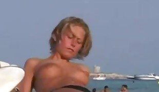 More stripped to the waist and naked beach girls
