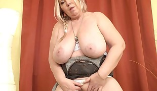 Euro Plus-size Dita works her pussy with thumbs and dildo